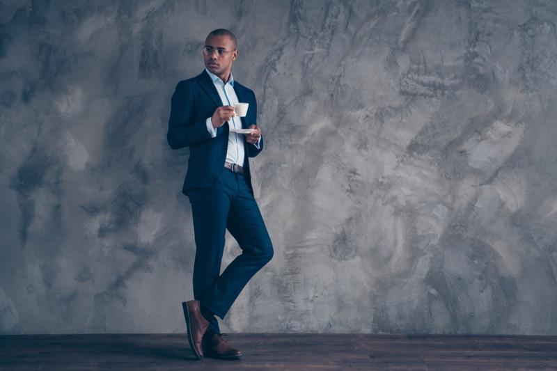 Black Man Suit Holding Coffee Tea Cup