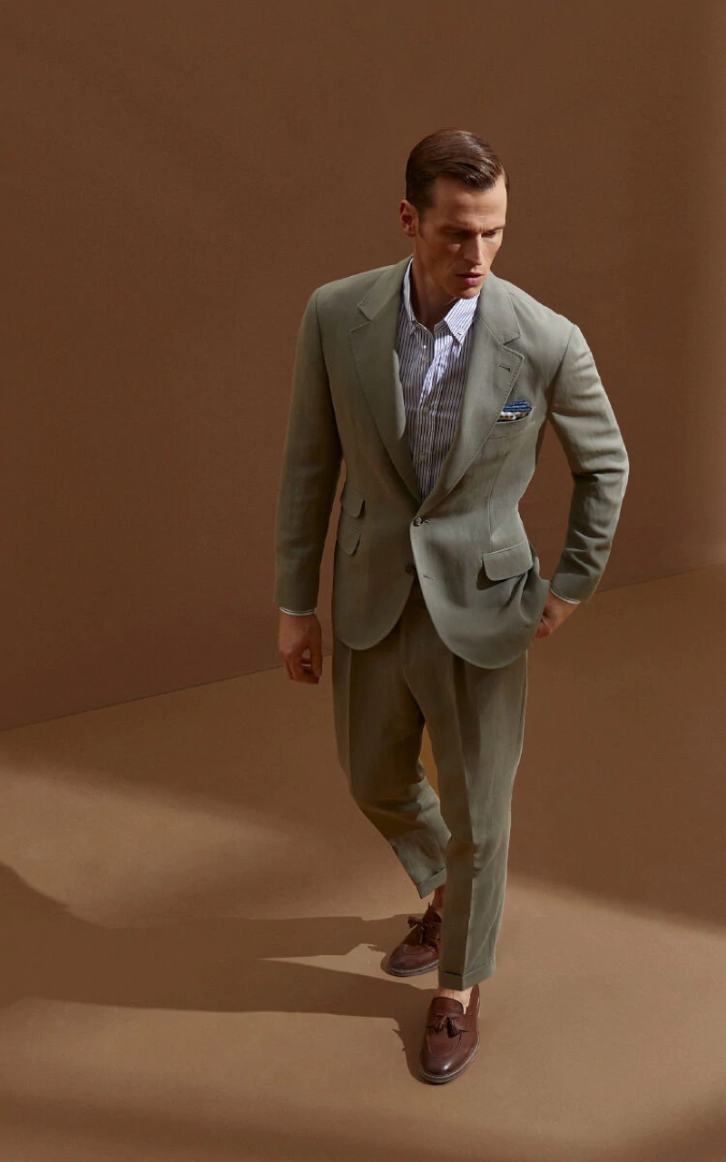 Lars Burmeister dons a linen and cotton satin deconstructed Cavallo suit from Brunello Cucinelli.