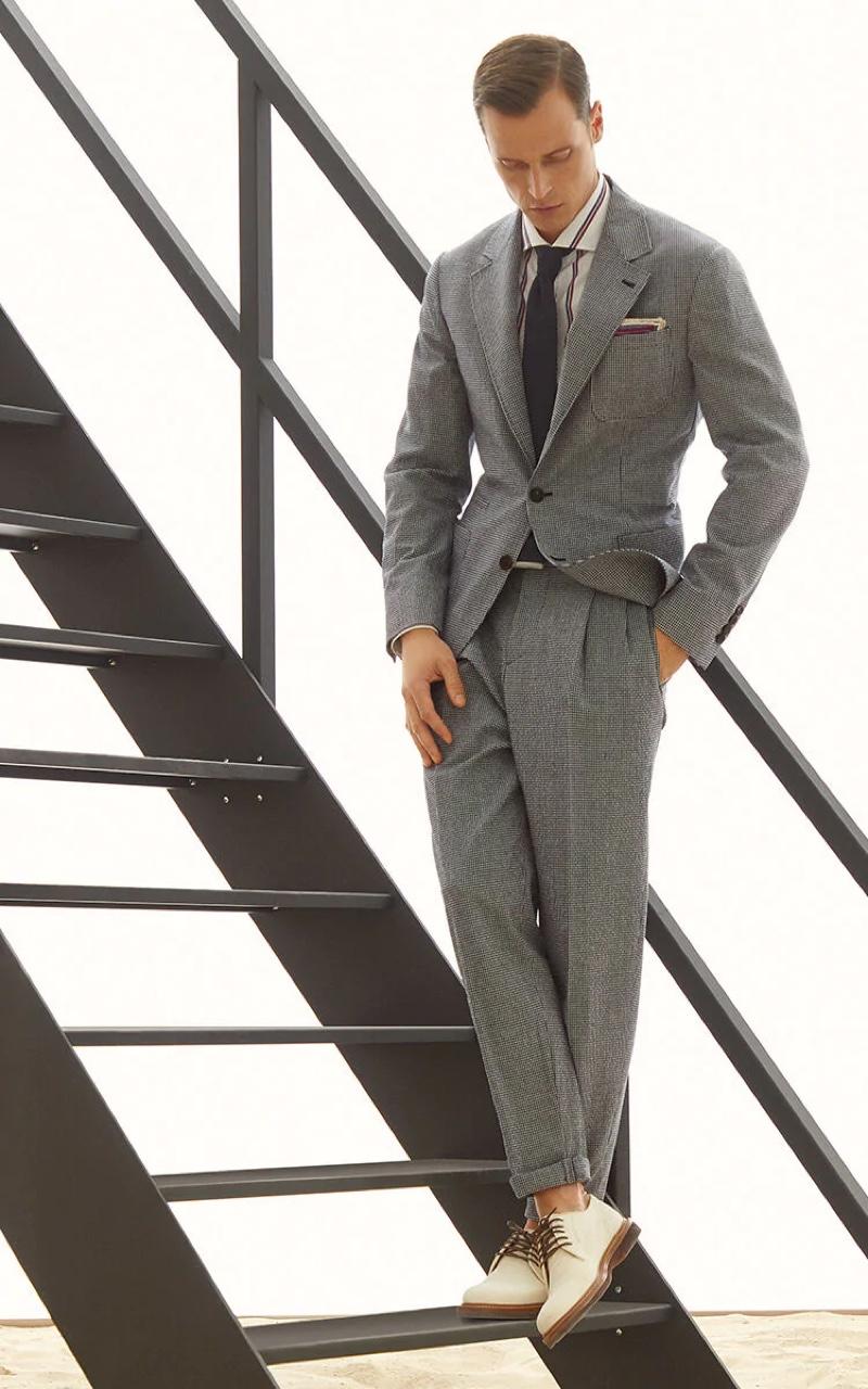 Model Lars Burmeister sports a comfort virgin wool checked seersucker deconstructed suit from Brunello Cucinelli.