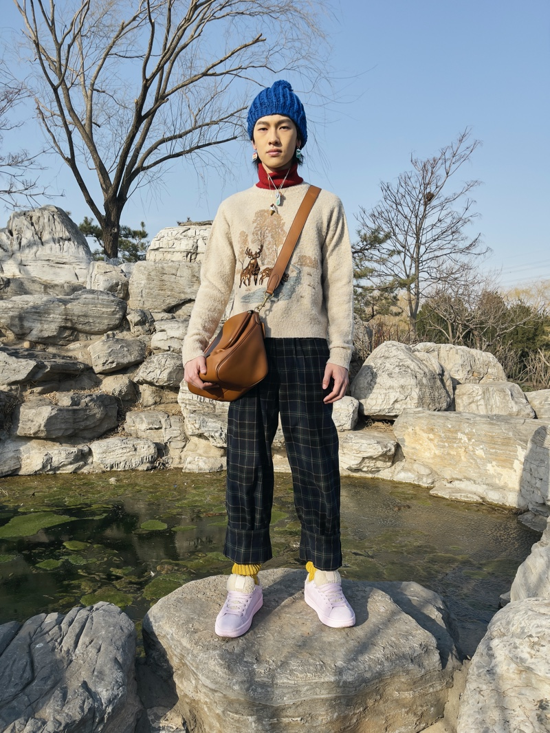 Front and center, Ma Zhe rocks a look from Coach's fall-winter 2021 men's collection.