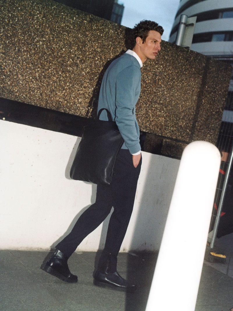 On the move, Tim Schuhmacher models smart pieces from the Core by COS collection.