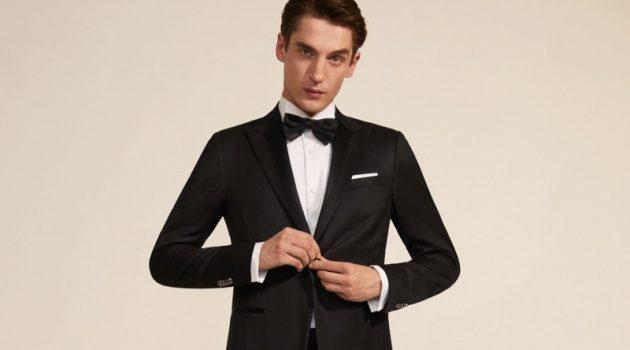 Front and center, Anatol Modzelewski dons a sharply tailored suit from Corneliani Cerimonia.