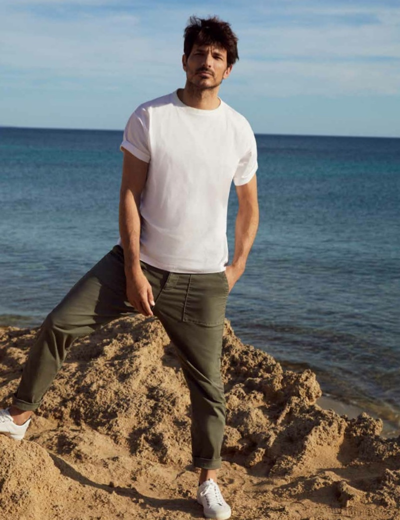 Going casual, Andres Velencoso sports a white t-shirt and relaxed pants from Esprit's spring-summer 2021 men's collection.
