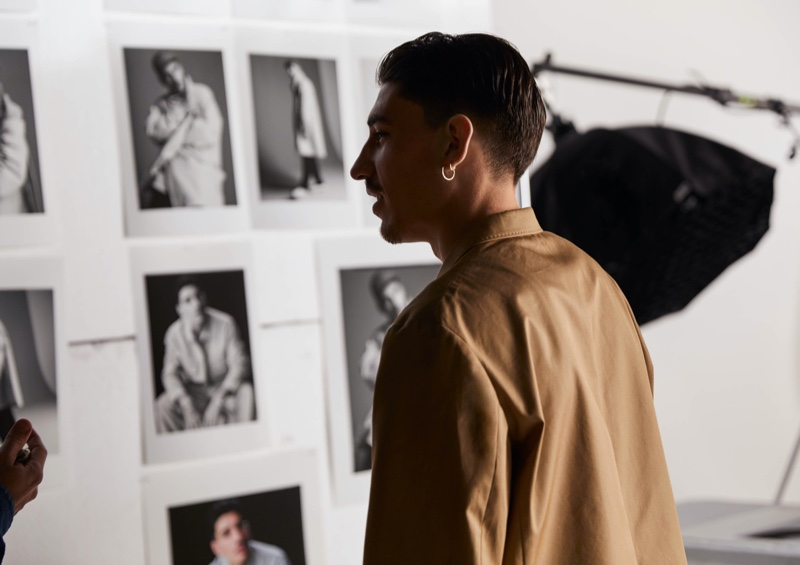 Connecting with H&M, Héctor Bellerín looks at images for his Edition collection campaign.