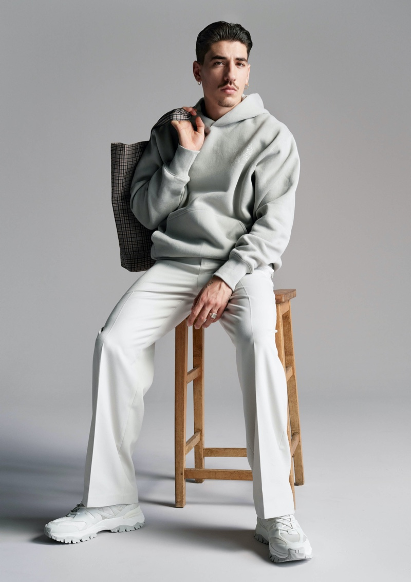 Footballer Héctor Bellerín wears a hoodie and trousers from his H&M Edition collection.