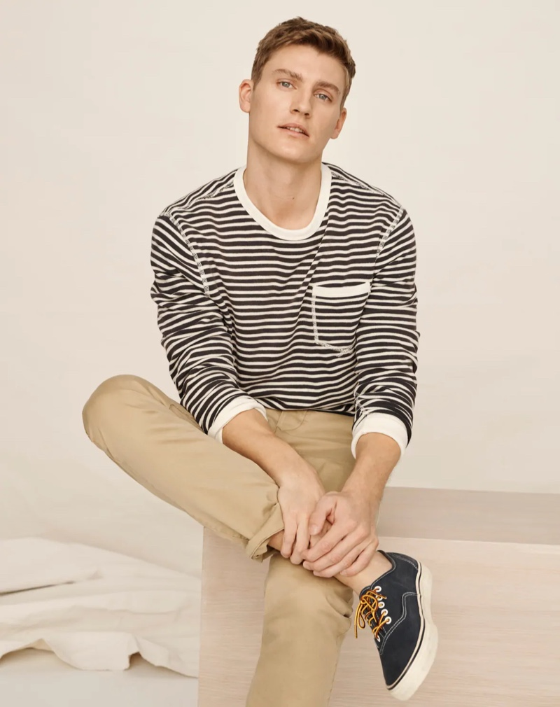 Front and center, Mikkel Jensen wears a J.Crew lightweight striped sun-faded french terry sweatshirt with Wallace & Barnes slim-fit military officer's chino pants.