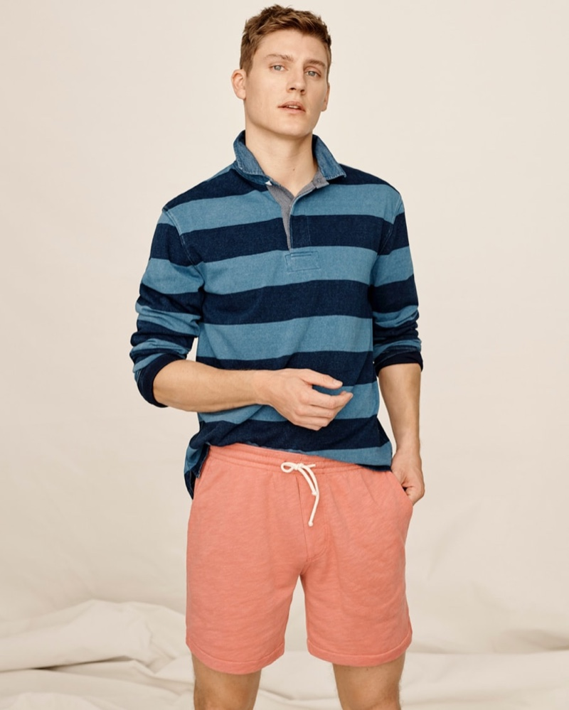 Showcasing iconic style, Mikkel Jensen models a striped J.Crew 1984 rugby shirt with lightweight sun-faded french terry dock shorts.