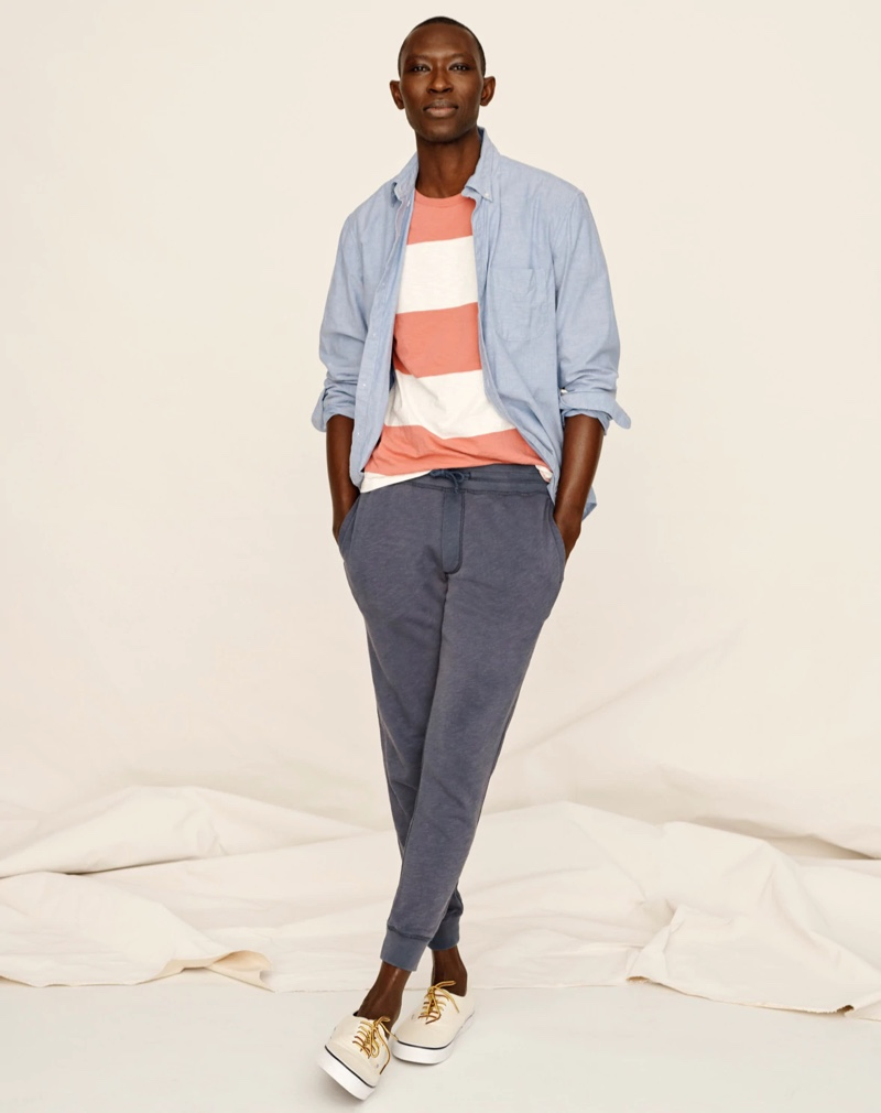 Going casual, Armando Cabral sports a J.Crew slim broken-in organic cotton oxford shirt, striped slub jersey pocket t-shirt, and lightweight sun-faded french terry jogger sweatpants.