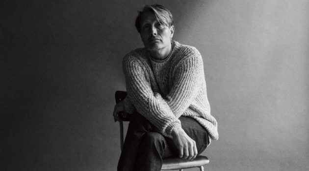 Mads Mikkelsen dons an Isabel Marant sweater with a Nanushka t-shirt, and A.P.C. jeans for WSJ Magazine.