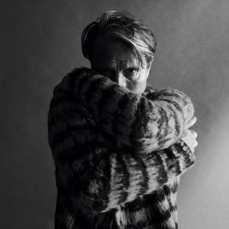 Connecting with WSJ Magazine for a new photoshoot, Mads Mikkelsen dons a Saint Laurent sweater.