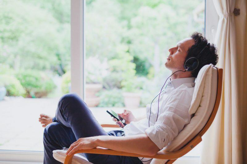 Man Meditating Listening to Headphones