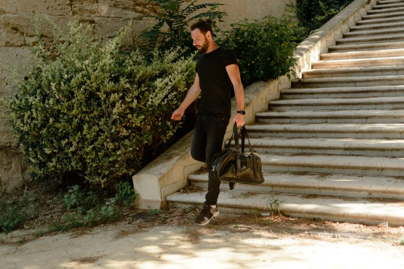 Man on the Move with Weekender Bag