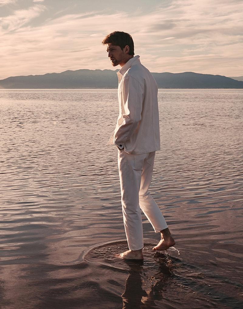 Donning a white denim look, Boyd Gates stars in Mango's spring-summer 2021 denim campaign.