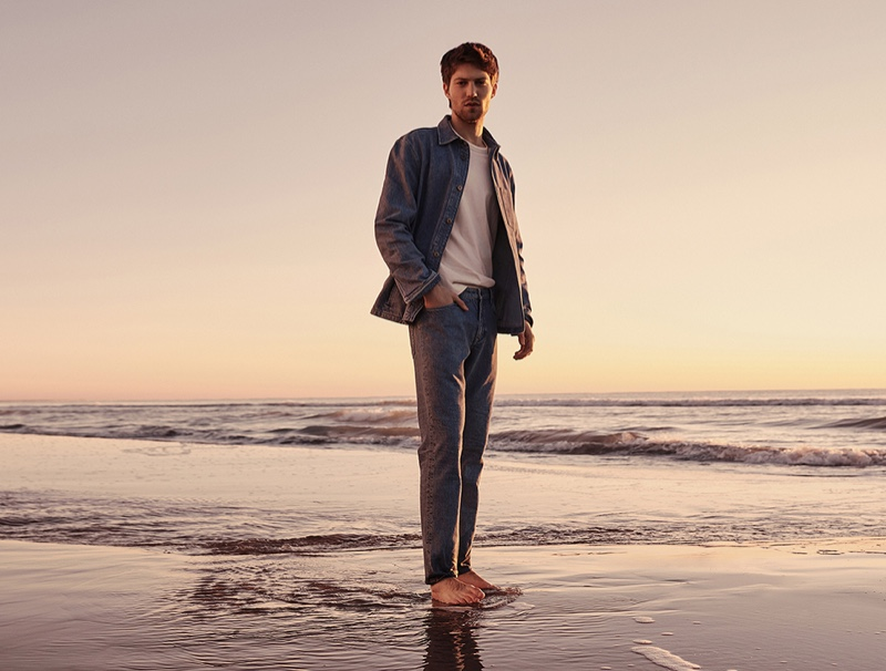 Taking to the Mediterranean, Boyd Gates appears in Mango's spring-summer 2021 denim campaign.