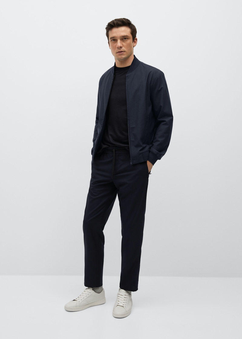 Alexis Petit models a technical merino wool bomber with pants from Mango's performance collection.