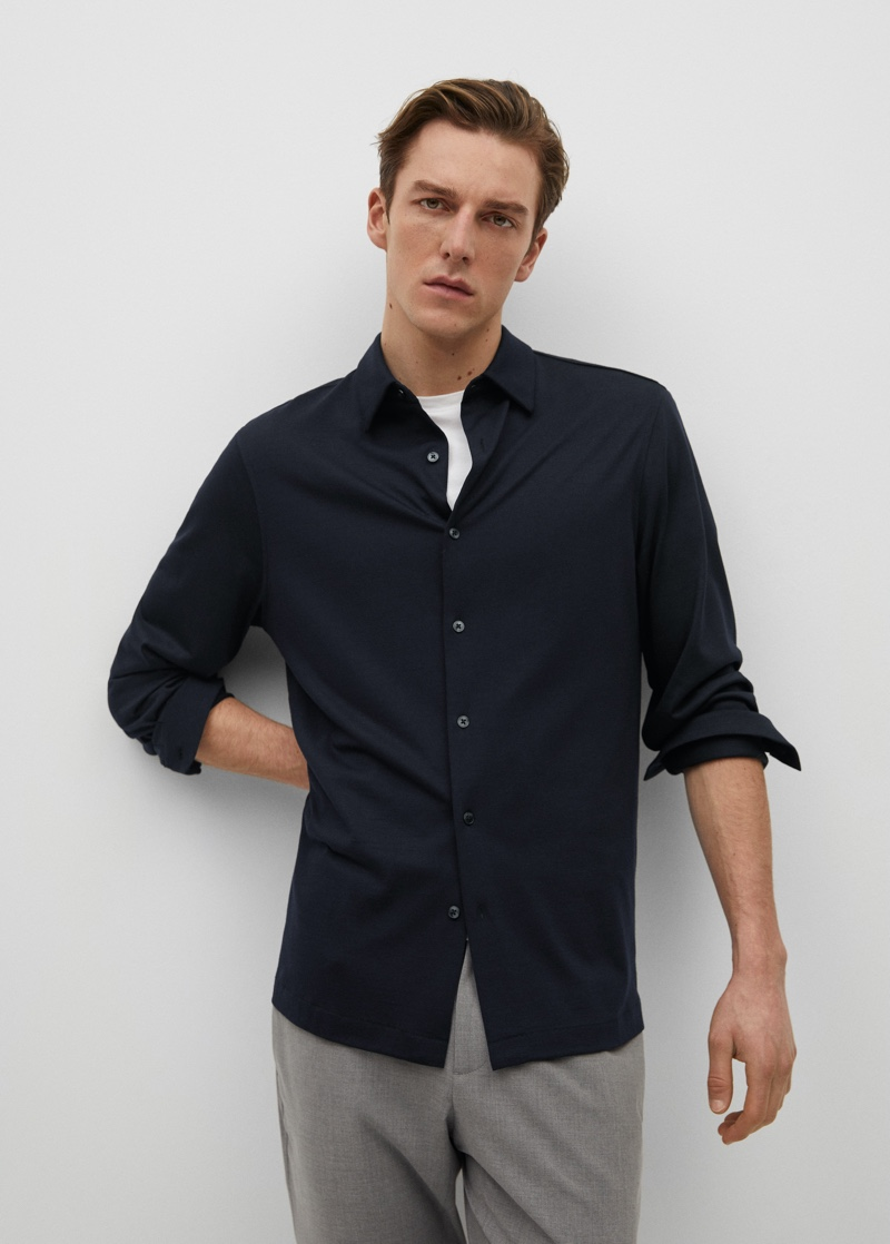 Quentin Demeester sports a slim-fit fluid technical shirt from Mango's performance collection.