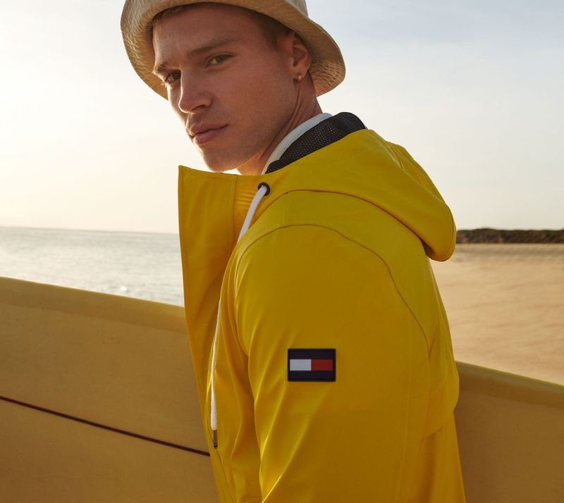 Sporting a yellow hooded jacket, Matthew Noszka fronts Tommy Hilfiger's spring-summer 2021 men's campaign.