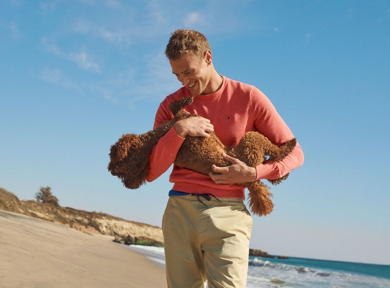 All smiles, Matthew Noszka shares the spotlight with a small dog for Tommy Hilfiger's spring-summer 2021 men's campaign.