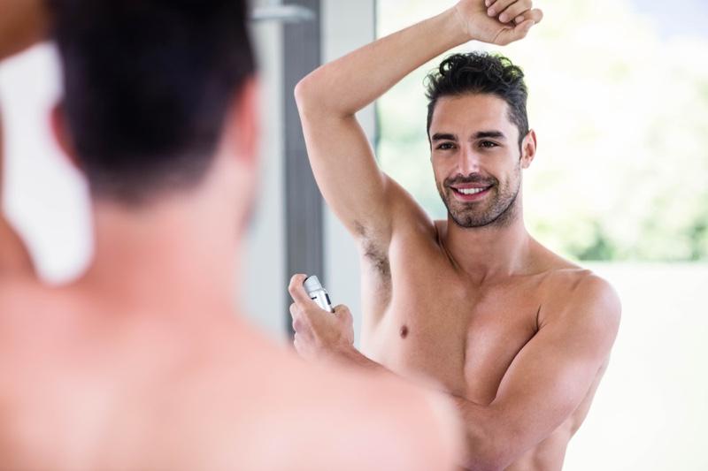Mirror Man Spraying Deodorant Arm