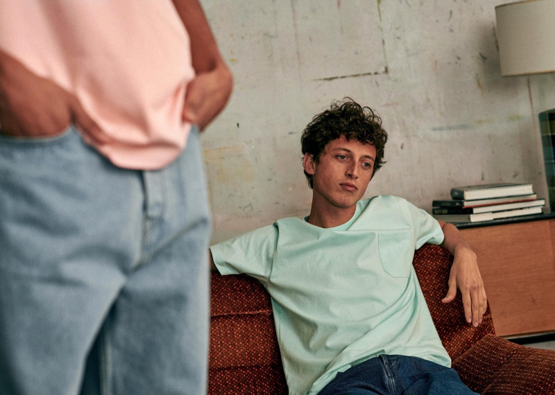 Alexis Maçon-Dauxerre models a pocket tee and denim jeans from Octobre Editions.