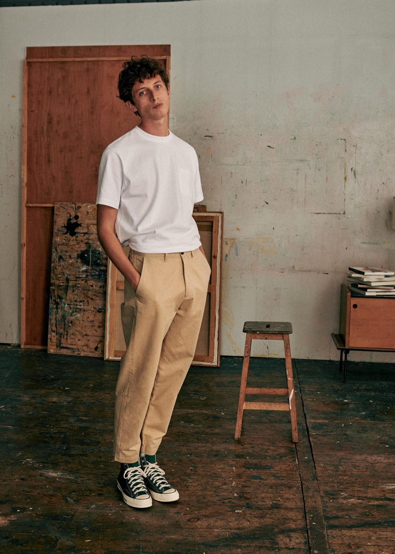 Making a case for smart chinos, Alexis Maçon-Dauxerre wears Octobre Editions.