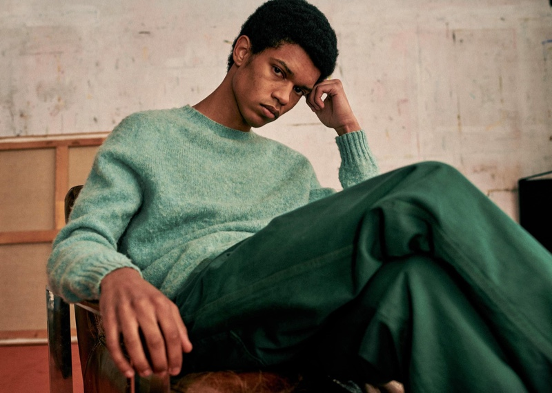 Sporting a sweater, Ruben Boa wears colored denim jeans from Octobre Editions.