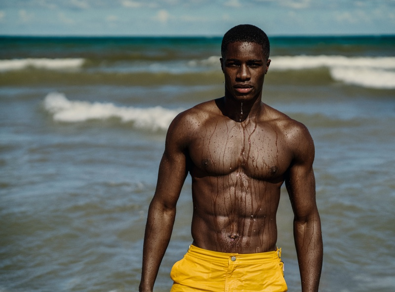 James Kakonge stands out in yellow swim shorts for Orlebar Brown's spring 2021 campaign.