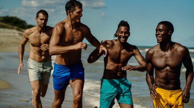 Models Andrew Cooper, Ollie Edwards, Ty Ogunkoya, and James Kakonge sport swimwear from Orlebar Brown's Atlantic collection.