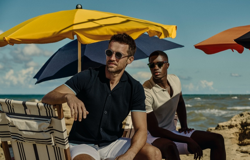 Enjoying a day at the beach, Andrew Cooper and James Kakonge showcase Orlebar Brown's new Atlantic collection.