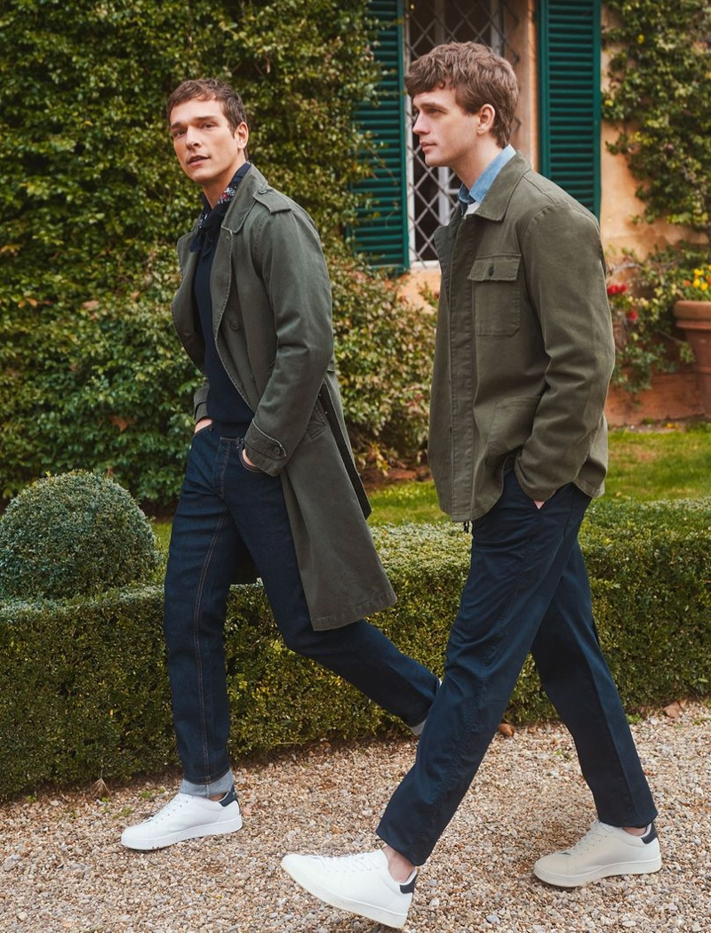Taking a stroll, models Alexandre Cunha and Benjamin Eidem wear essentials like the trench coat for OVS Piombo's spring-summer 2021 campaign.