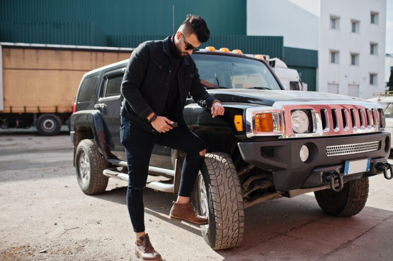 Stylish Man with SUV