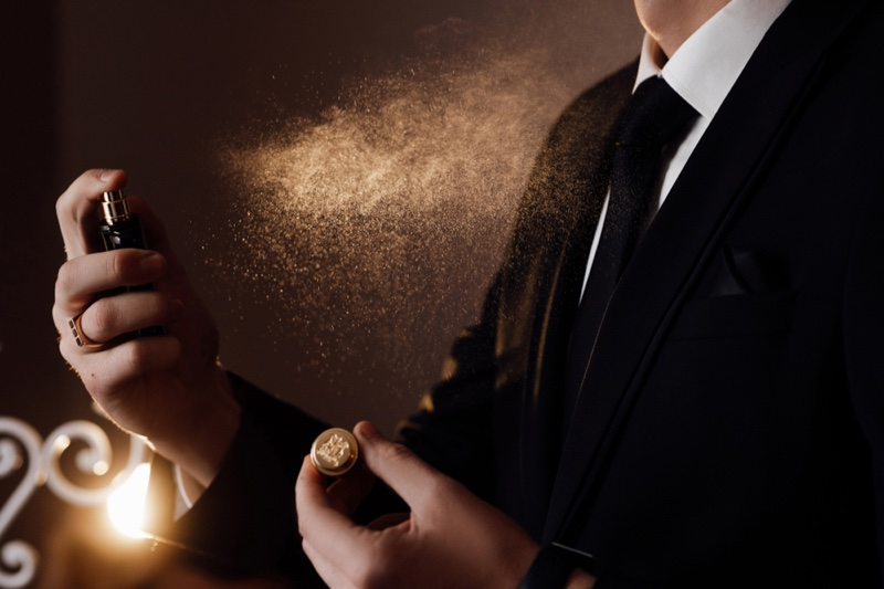 Suit Wearing Man Spraying Cologne Fragrance