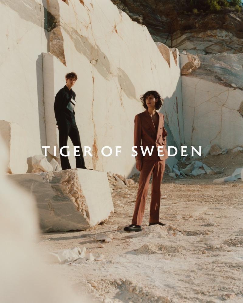 Models Serge Sergeev and Adam de la Tour appear in Tiger of Sweden's spring-summer 2021 men's campaign.