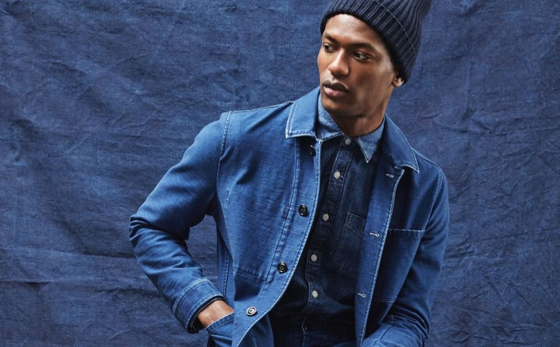 Hamid Onifade dons an indigo Japanese French chore coat and denim button-down shirt from Todd Snyder.