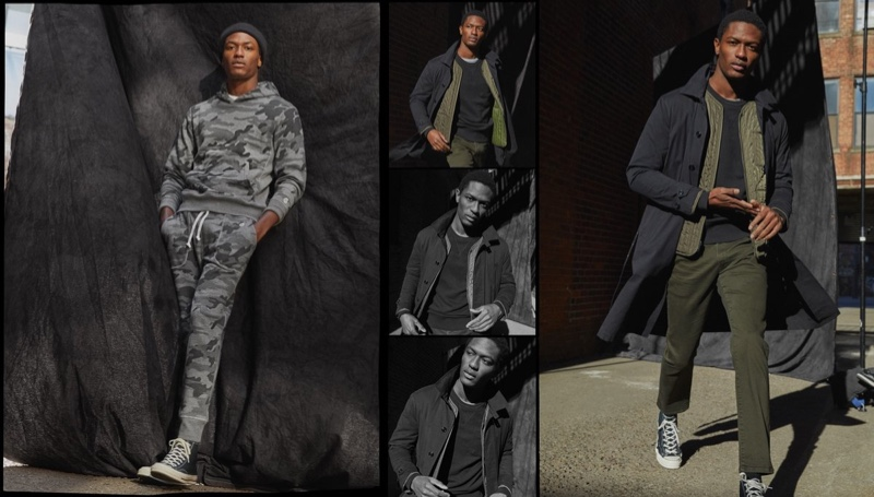 Embracing sporty style, Hamid Onifade is pictured left in a Todd Snyder + Champion heather grey camo popover hoodie and slim jogger sweatpants. Right: Hamid rocks a Todd Snyder 3-1 Italian trench and slim-fit 5-pocket chinos with a Todd Snyder + Champion midweight pocket sweatshirt.