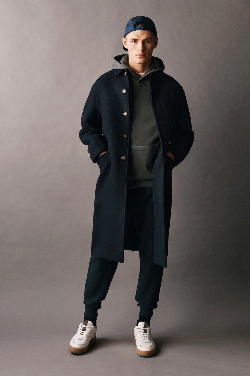 Rocking an oversized coat and leisurewear, Finley Prentice wears Zara Man.