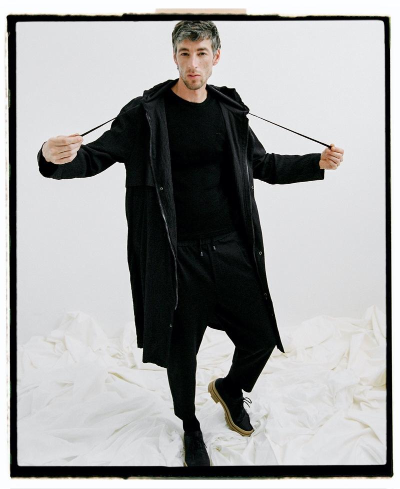 Sporting a casual spring look in black, Joel Frampton wears Adolfo Dominguez.