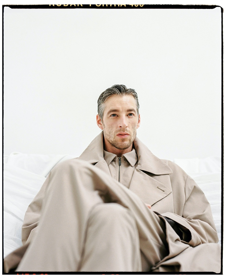 Rocking an oversized trench, Joel Frampton models the latest menswear from Adolfo Dominguez.