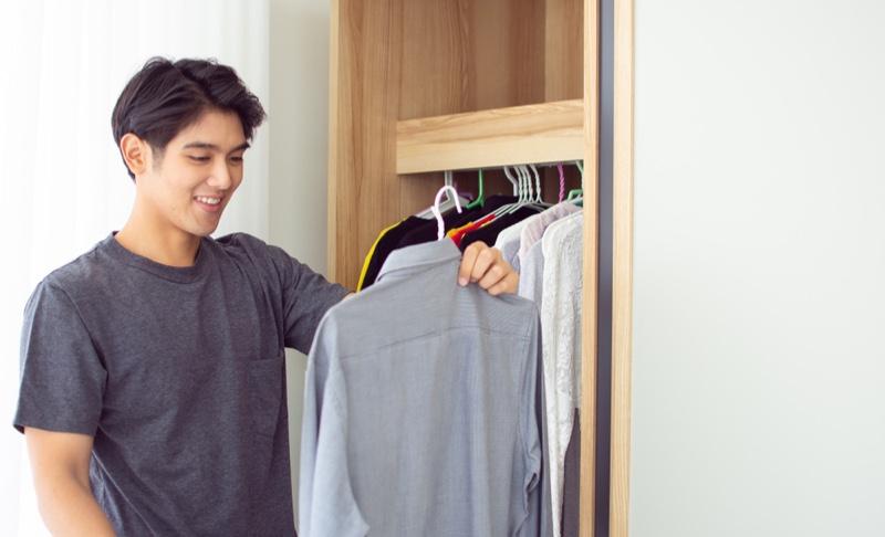 Asian Man Closet Choosing Shirt