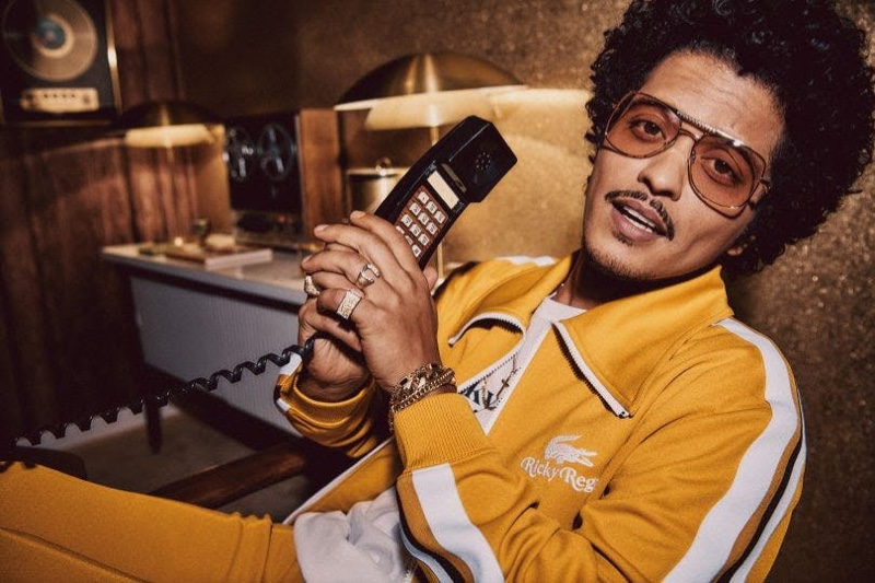 Bruno Mars rocks a yellow tracksuit from his Lacoste Ricky Regal collection.