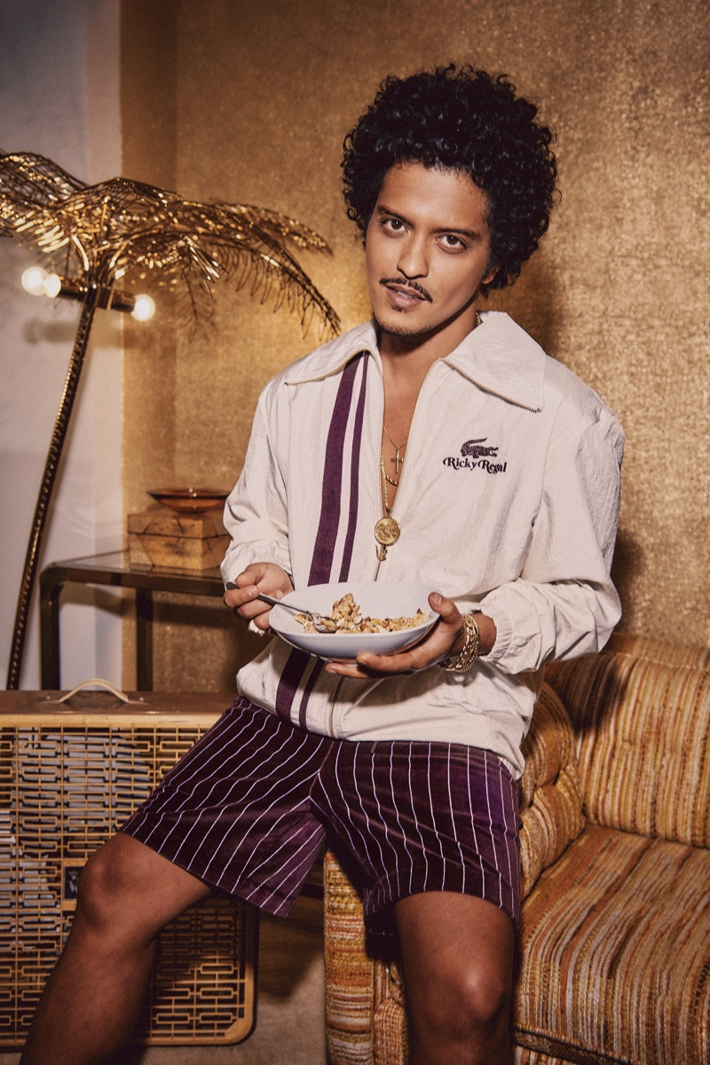 Embracing a retro charm, Bruno Mars stars in the campaign for his Lacoste Ricky Regal collection campaign.
