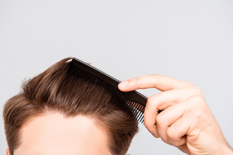 Closeup Man Combing Hair