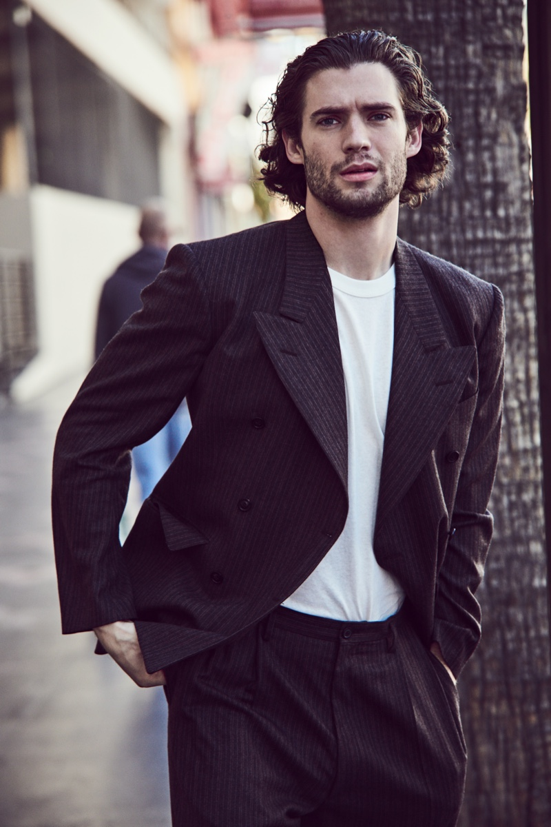 David Corenswet dons a Maison Margiela pinstripe suit for Mytheresa's spring-summer 2021 men's campaign.