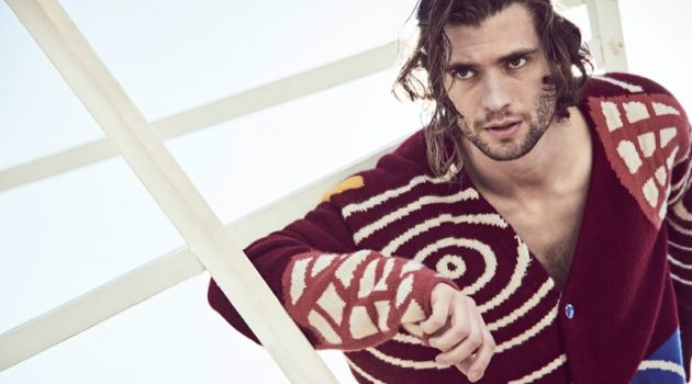 Connecting with Mytheresa for its spring-summer 2021 campaign, David Corenswet wears a chunky cardigan by The Elder Statesman.