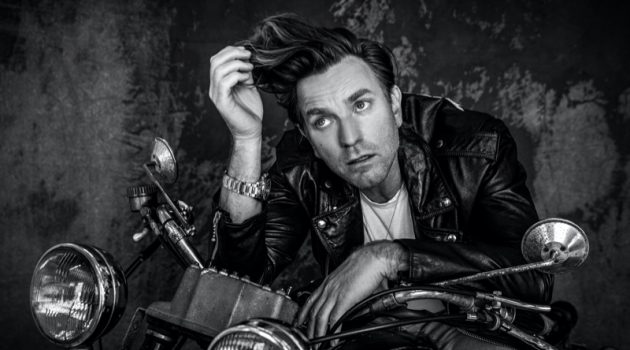 Rocking a Celine leather biker jacket, Ewan McGregor also wears a Tiffany & Co. necklace and TAG Heuer watch for VMAN.