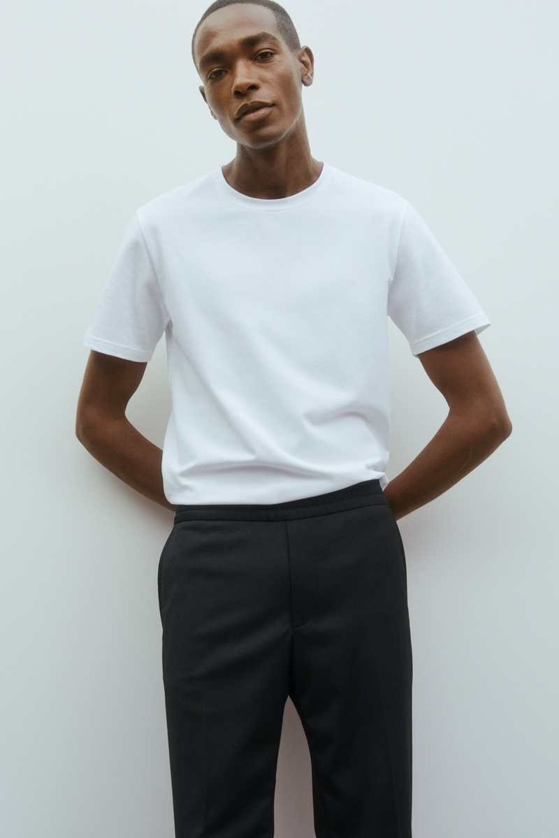Sharif Idris models a crisp white t-shirt and trousers from Filippa K's Core collection.