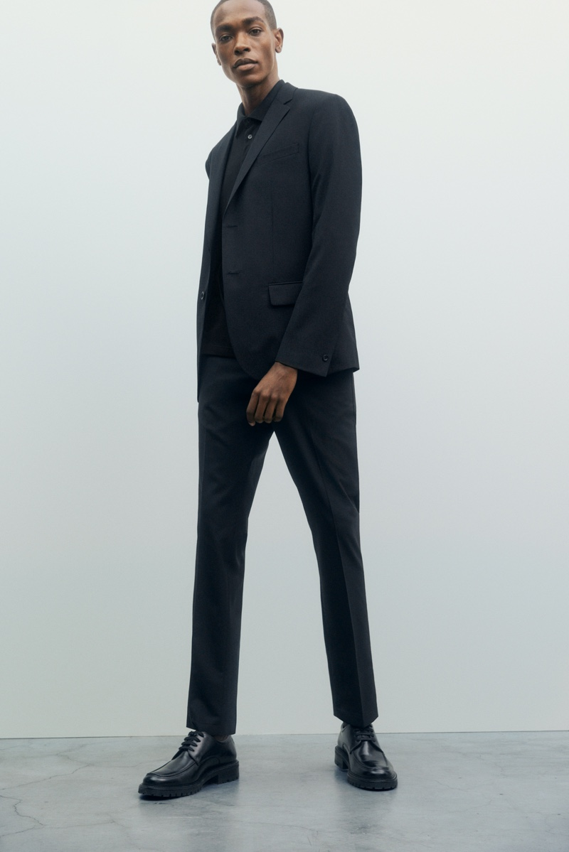Donning a sleek suit and polo, Sharif Idris showcases must-have pieces from Filippa K's Core collection.