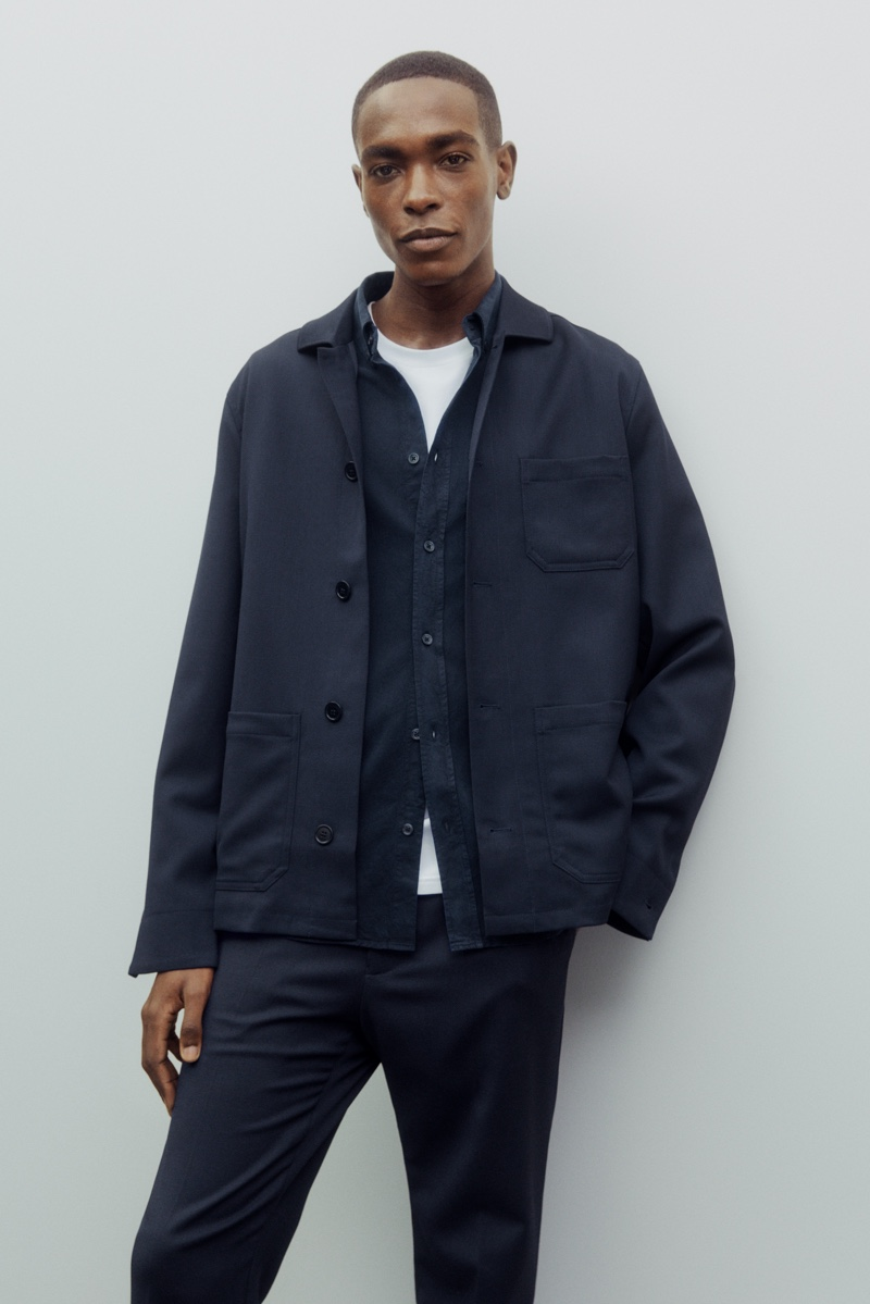 Sporting a shirt jacket, Sharif Idris also sports a shirt and trousers from Filippa K's Core collection.