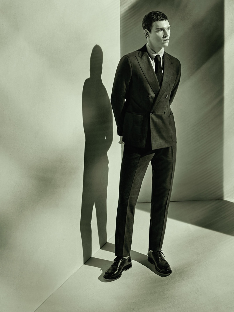 Donning a double-breasted suit, Alexandre Cunha stars in Giorgio Armani's spring-summer 2021 men's campaign.