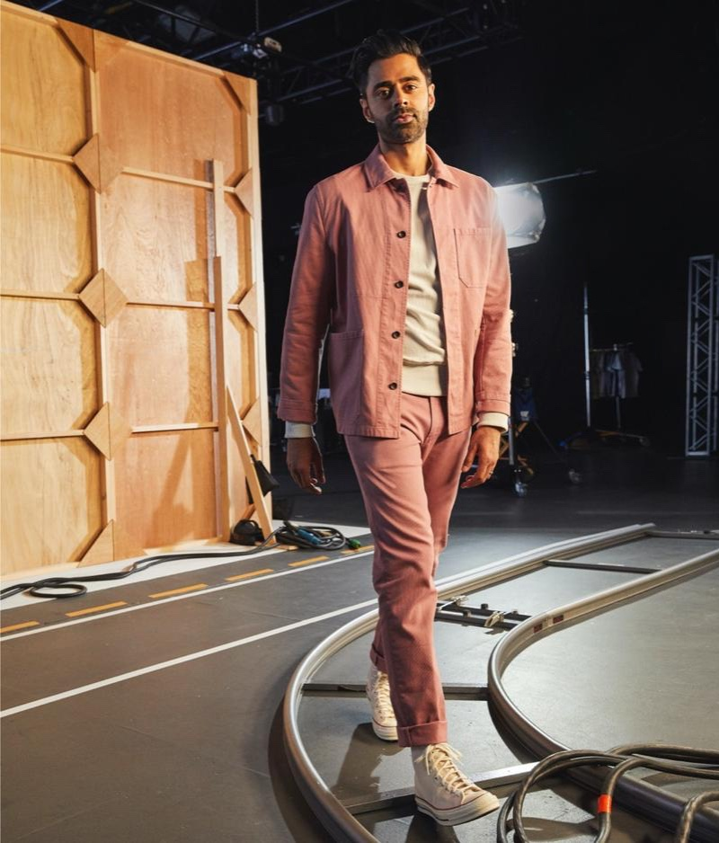 Hasan Minhaj wears a Todd Snyder Bedford cord chore coat and slim fit 5-pocket cord pants in rosewine.